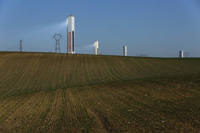 """Towers belonging to the Abengoa Solar plant is seen at the """"Solucar"""" solar park in Sanlucar la Mayor, near the Andalusian capital of Seville, southern Spain November 30, 2015. (Photo by Marcelo del Pozo/Reuters)"""