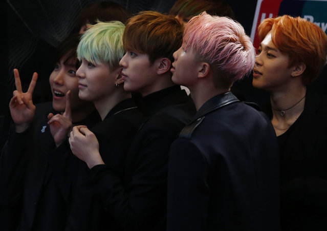 Members of South Korean K-Pop band BTS react on the red carpet during 2015 Mnet Asian Music Awards (MAMA) in Hong Kong, China, December 2, 2015. (Photo by Bobby Yip/Reuters)