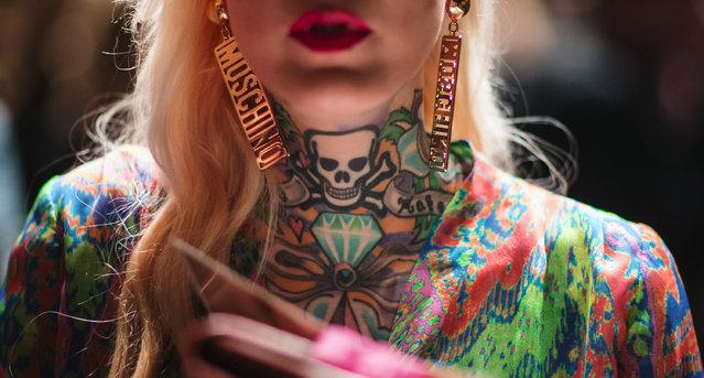 A tattooed women follows the show of designer Lena Hoschek at the Berlin Fashion Week Autumn/Winter 2015 in Berlin January 20, 2015. (Photo by Hannibal Hanschke/Reuters)