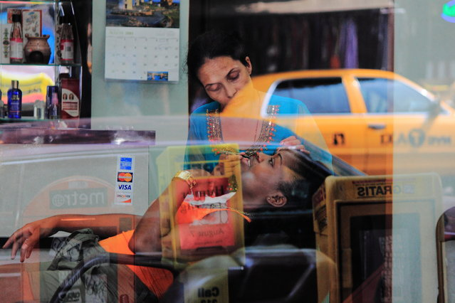 """Sharing the Big Apple"". Inside and outside merge sweetness and circumstances in glass transparency and reflex – New York summer 2011. (Photo and caption by Iago Barbeiro/National Geographic Traveler Photo Contest)"