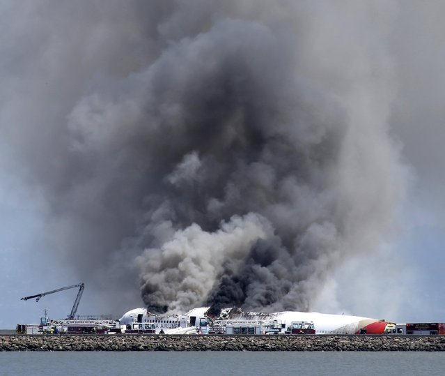 Fire crews are on the scene after an Asiana Airlines Boeing 777 crashed on landing at San Francisco International Airport in San Francisco, California, on Saturday, July 6, 2013. (Photo by John Green/Bay Area News Group/MCT)