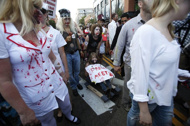 People dressed up as zombies take part in a zombie walk in the Gaslamp Quarter during the Comic Con International convention in San Diego, California July 13, 2012. (Photo by Mario Anzuoni/Reuters)