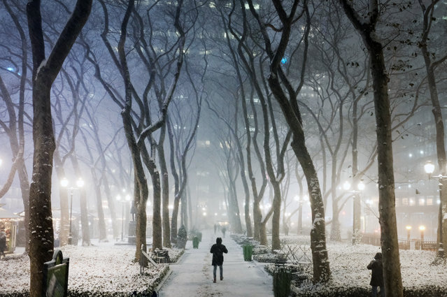 People walk through Manhattan in a snow storm on December 16, 2020 in New York City. New York City is expected to get between 10 inches and a foot of snow on Wednesday and Thursday in what is the first winter storm of the year. (Photo by Spencer Platt/Getty Images)