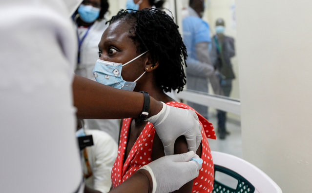A woman reacts as she receives the AstraZeneca/Oxford vaccine under the COVAX scheme against coronavirus disease (COVID-19) at the Kenyatta National Hospital in Nairobi, Kenya on March 5, 2021. (Photo by Monicah Mwangi/Reuters)
