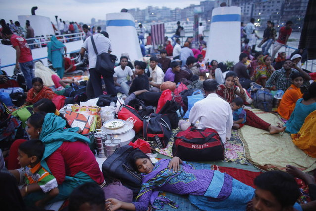 An overcrowded passenger boat prepares to depart as people return to their hometowns ahead of Eid al-Fitr at Sadarghat in Dhaka August 7, 2013. Millions of residents in Dhaka have started the exodus home from the capital city ahead of the Eid al-Fitr holiday, which marks the end of the fasting month of Ramadan. (Photo by Andrew Biraj/Reuters)