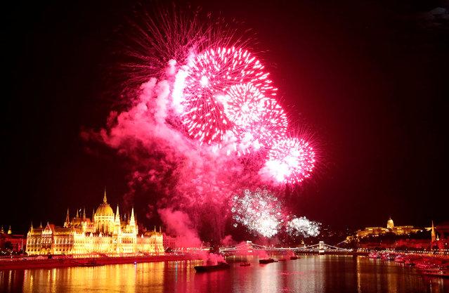 Fireworks explode over Danube River during Saint Stephen's Day in Budapest, Hungary, August 20, 2018. (Photo by Bernadett Szabo/Reuters)