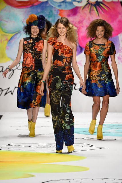 Behati Prinsloo (C) walks the runway at the Desigual fashion show during Mercedes-Benz Fashion Week Fall 2015 at The Theatre at Lincoln Center on February 12, 2015 in New York City. (Photo by Frazer Harrison/Getty Images for Mercedes-Benz Fashion Week)