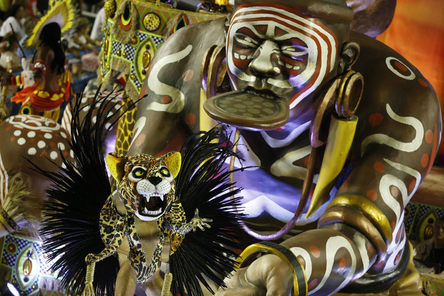 A performer from the Imperatriz Leopoldinense samba school parades during carnival celebrations at the Sambadrome in Rio de Janeiro, Brazil, Tuesday, February 17, 2015. (Photo by Leo Correa/AP Photo)