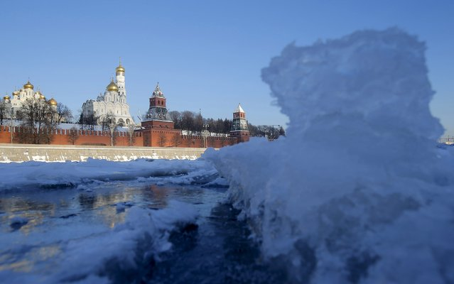 A view shows the ice-covered Moskva River with the Kremlin towers seen in the background in Moscow, Russia, January 11, 2016. (Photo by Maxim Shemetov/Reuters)