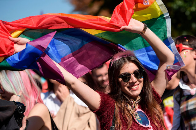 """Kosovo citizens march with rainbow flags during the Gay Pride parade in Pristina on October 10, 2018. Hundreds of Kosovans marched along the main street on October 10 during a Gay parade demanding """"freedom"""" and """"equal rights"""" in the patriarchal and Muslim majority country with little tolerant views on sexuality. Waving rainbow flags and banners with the motto of the parade """"In the Name of Freedom"""", they also said that they were """"walking for those who cannot join us"""". (Photo by Armend Nimani/AFP Photo)"""