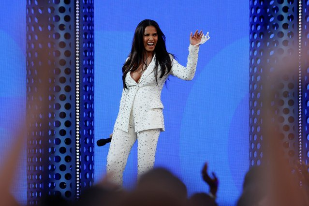Indian American television host Padma Lakshmi salutes from the stage at the 2021 Billboard Music Awards outside the Microsoft Theater in Los Angeles, California, U.S., May 23, 2021