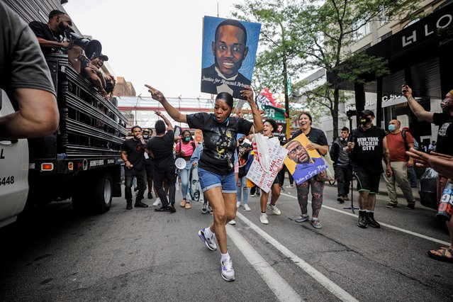 """People react as they march during the """"One Year, What's Changed?"""" rally hosted by the George Floyd Memorial Foundation to commemorate the first anniversary of his death, in Minneapolis, Minnesota, U.S. May 23, 2021. (Photo by Nicholas Pfosi/Reuters)"""