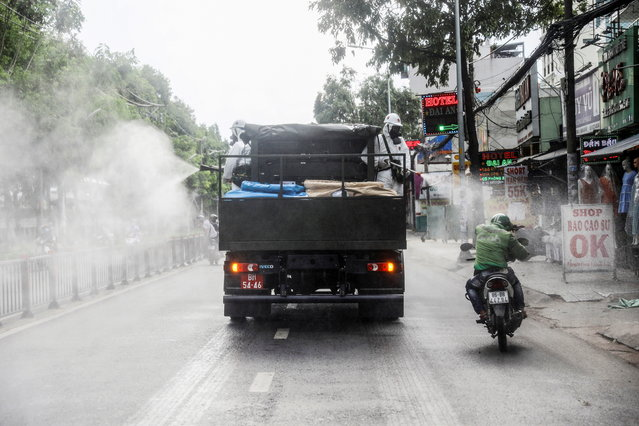 A truck sprays disinfectant amid the coronavirus disease (COVID-19) outbreak in Ho Chi Minh city, Vietnam on June 1, 2021. (Photo by Reuters/Stringer)