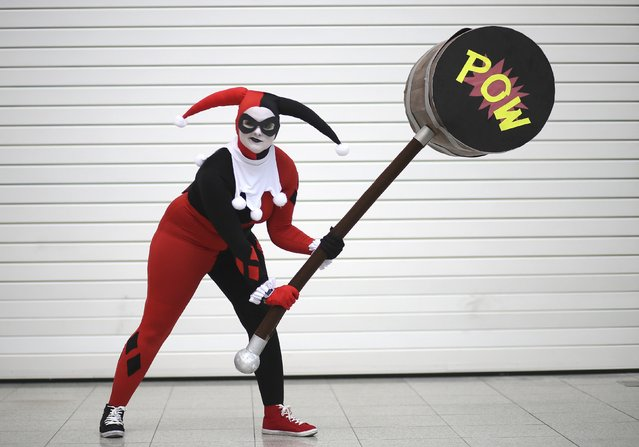 Tori Seager dressed as Harley Quinn from the Batman comic book poses for a photograph at the London supercomic convention at the Excel centre, east London, March 14, 2015. (Photo by Paul Hackett/Reuters)