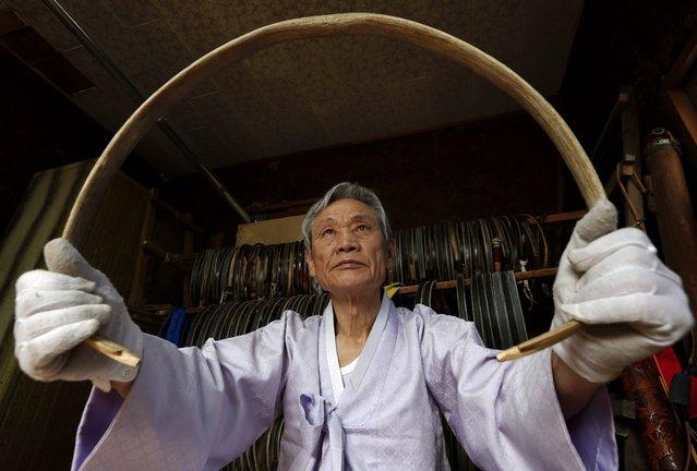 South Korean traditional bow artisan Kwon Yeong-Hak works on a bow in his workshop in Yecheon-gun, Gyeongsangbuk-do, South Korea, 26 February 2015. (Photo by Jeon Heon-Kyun/EPA)
