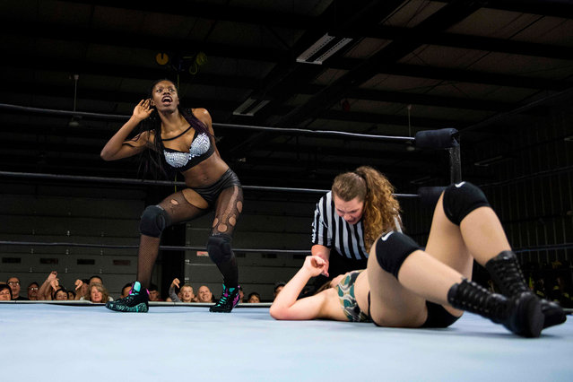 Professional wrestler Gia Scott (L) listens to the crowd' s boos after smacking professional wrestler Aria Palmer (R) to the mat during Autumn Armageddon 2018 in Galena, Maryland on October 6, 2018. (Photo by Jim Watson/AFP Photo)