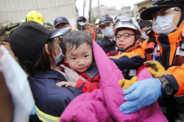 A baby boy is rescued from a collapsed building after an earthquake in Tainan, Taiwan, Saturday, February 6, 2016. (Photo by Wally Santana/AP Photo)