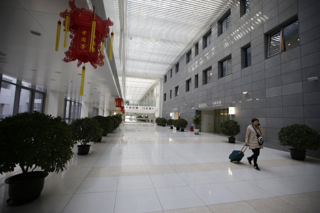 A woman walks inside the Peking Union Medical College Hospital on the eve of the Chinese Lunar New Year, in Beijing, China, February 7, 2016. (Photo by Jason Lee/Reuters)
