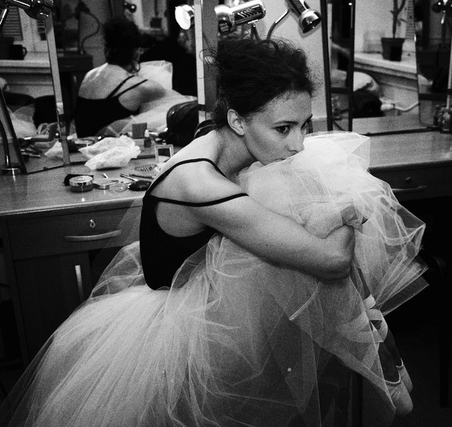 """""""Sorrow"""". The photograph was taken in one of the Moscow's theater called Teatr Mossoveta. Actress of this theater Lili Bolgashvili is in the picture. (Photo and caption by Eugene Stulov (Russia)/2014 Sony World Photography Awards)"""