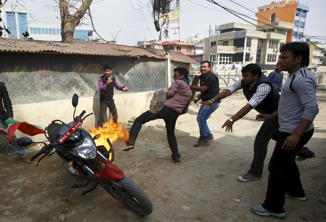Protesters set a motorcycle alight during a nationwide strike, organised by the opposition alliance led by the Unified Communist Party of Nepal (Maoist) to demand the new constitution be drafted with the consensus of all political parties, in Kathmandu April 7, 2015. (Photo by Navesh Chitrakar/Reuters)