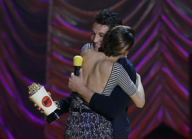 Actress Woodley embraces Miles Teller as he presents her with the MTV Trailblazer Award at the 2015 MTV Movie Awards in Los Angeles, California April 12, 2015. (Photo by Mario Anzuoni/Reuters)