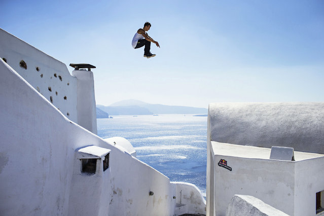 A handout picture made available by Global Newsroom on 02 October 2014 of Aleksandr Baiturin of Russia performing during the preshoot at Oia area on the island of Santorini, Greece, 02 October 2014. The Red Bull Art of Motion, a free running event on the Greek island of Santorini, will take place on 04 October 2014. (Photo by Samo Vidic/EPA/Global Newsroom)