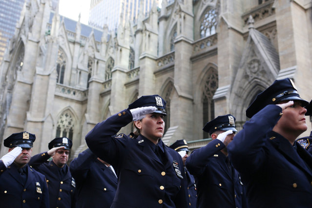 New York Police Department officers honor Officer Steven McDonald outside his funeral at St. Patricks Cathedral in Manhattan, New York City, U.S., January 13, 2017. (Photo by Alex Wroblewski/Reuters)