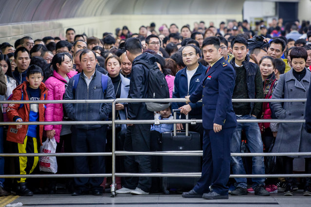 Passengers wait to enter a railway station during the annual Spring Festival travel rush ahead of the Chinese Lunar New Year in Guangzhou, Guangdong province, China January 14, 2017. (Photo by Reuters/Stringer)