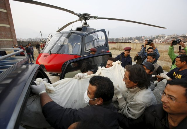The body of one of the crew members of a Twin Otter plane, operated by private Tara Air, that crashed on Wednesday is carried to a vehicle from a helicopter at teaching hospital in Kathmandu, Nepal, February 25, 2016. (Photo by Navesh Chitrakar/Reuters)