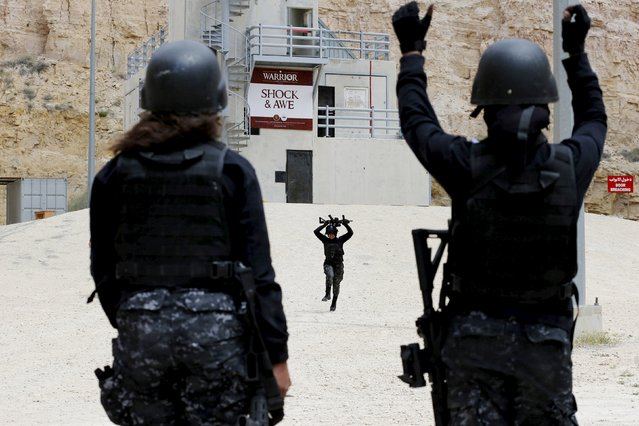 A member of the Jordanian police women's team competes in the 7th Annual Warrior Competition at the King Abdullah Special Operations Training Center in Amman April 22, 2015. (Photo by Muhammad Hamed/Reuters)