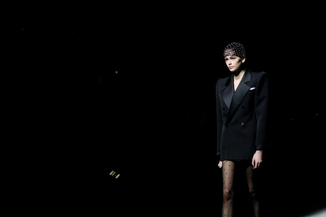 Kaia Gerber presents a creation by designer Anthony Vaccarello as part of his Fall/Winter 2019-2020 women's ready-to-wear collection for fashion house Saint Laurent during Paris Fashion Week in Paris, France, February 26, 2019. (Photo by Stephane Mahe/Reuters)