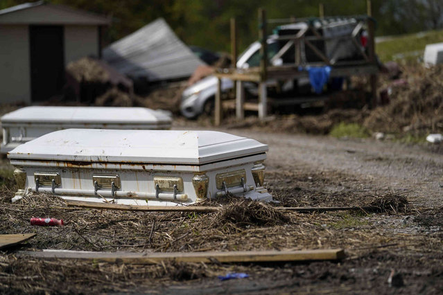 Displaced caskets that floated away from a cemetery during flooding sits along a road in Ironton, La., Monday, September 27, 2021. A month after Hurricane Ida, small communities along Louisiana's southeastern coast are still without power or running water. Some residents have lost most of their possessions to the storm's floodwaters. (Photo by Gerald Herbert/AP Photo)