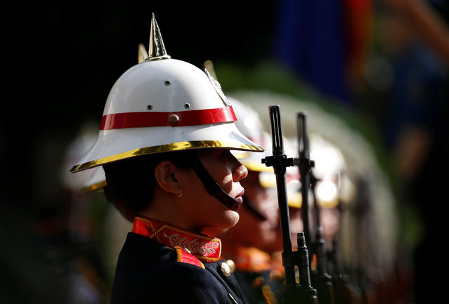 Members of Philippine National Police honour guard hold their weapons during a wreath-laying ceremony for policemen killed in action, during the police founding anniversary of the Philippine National Police event at Camp Crame, in Quezon city Metro Manila, Philippines February 6, 2017. (Photo by Erik De Castro/Reuters)