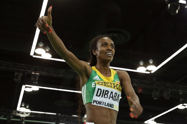 Genzebe Dibaba of Ethiopia celebrates after winning the women's 3000 meters final during the IAAF World Indoor Athletics Championships in Portland, Oregon March 20, 2016. (Photo by Lucy Nicholson/Reuters)