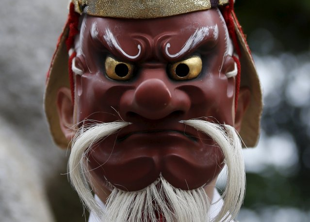 A man wearing a mask of a Tengu or Japanese long-nosed goblin, attends a ritual for the Kanda festival at the Kanda-Myojin shrine in Tokyo May 9, 2015. The festival dating back to the Edo period is one of the three major festivals in Tokyo. (Photo by Toru Hanai/Reuters)
