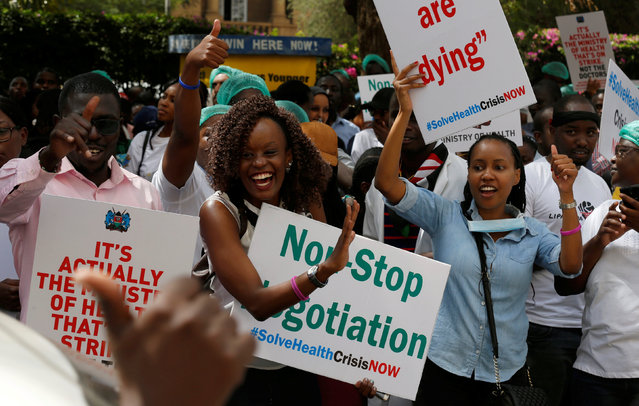 Striking doctors hold placards and chant slogans outside the Court of Appeal as they wait for the release of jailed officials of the national doctors' union in their case to demand fulfilment of a 2013 agreement between their union and the government that would raise their pay and improve working conditions in Nairobi, Kenya, February 15, 2017. (Photo by Thomas Mukoya/Reuters)