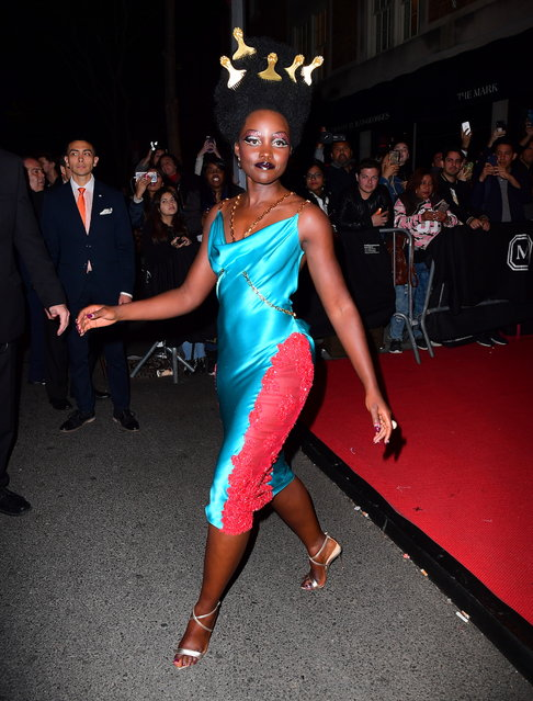 Lupita Nyong'o Looks Glamorous in Aqua Dress as she Parties After the Met Gala on May 7, 2019. (Photo by DIGGZY/Splash News and Pictures)