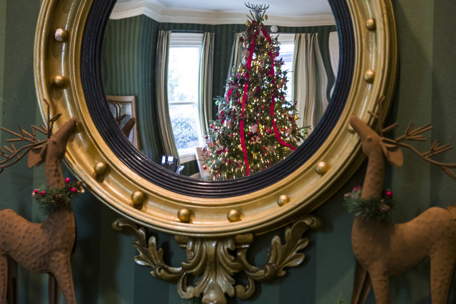 Holiday decorations are seen reflected in a mirror at the Vice President's residence, Thursday, December 6, 2018, in Washington. (Photo by Alex Brandon/AP Photo)