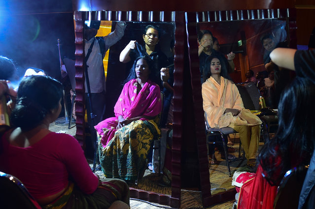 "Bangladeshi acid attack survivors are reflected in mirrors as they have their hair done backstage prior to the fashion show ""Beauty Redefined"" by designer Bibi Russell featuring acid attack survivors in Dhaka on March 7, 2017. Women fighting to overcome the trauma of acid attacks hold a fashion show to mark International Women's Day. (Photo by AFP Photo/Stringer)"