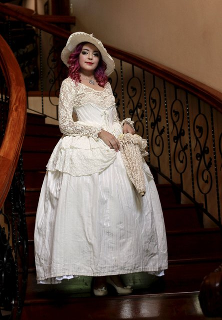 "Adriana Barahona, known as ""Madame Barocle,"" poses in Victorian era clothing at her house in Heredia, Costa Rica, June 4, 2015. Barahona says she has been passionate about clothing from the era of Britain's Queen Victoria (1837-1901), and has been making and wearing them since the age of 15. REUTERS/Juan Carlos Ulate"