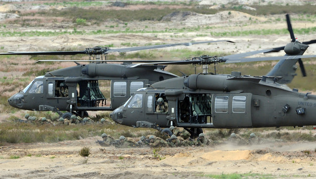 U.S. Army helicopters support soldiers during the NATO Noble Jump exercise on a training range near Swietoszow Zagan, Poland, Thursday, June 18, 2015. (AP Photo/Alik Keplicz)