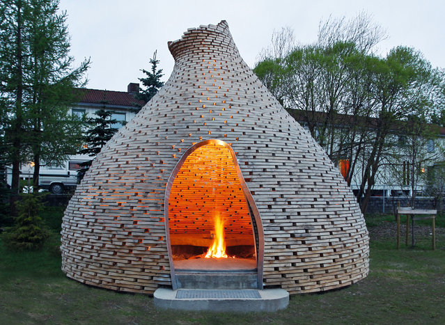 Fireplace for children, Trondheim, Norway, by Haugen/Zohar. The children of Trondheim come to sit around the fire and tell stories in this whimsical cone hut, made with materials recycled from a construction site. (Photo by Jason Havneraas/The Guardian)