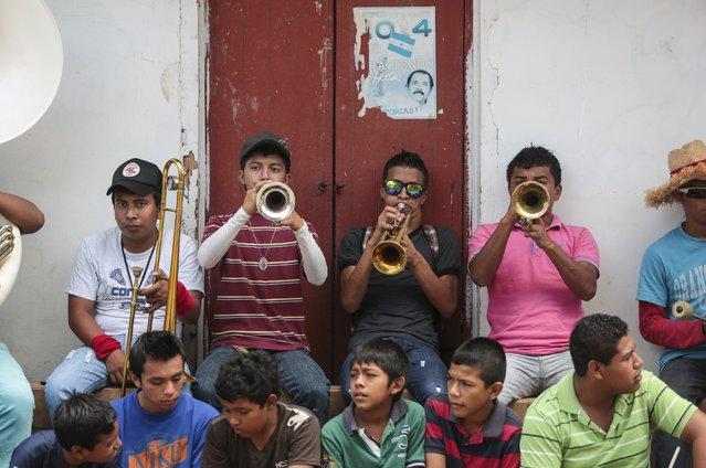 Young men play trumpets during celebrations in honour of San Juan Bautista in San Juan de Oriente town, Nicaragua, June 26, 2015. (Photo by Oswaldo Rivas/Reuters)