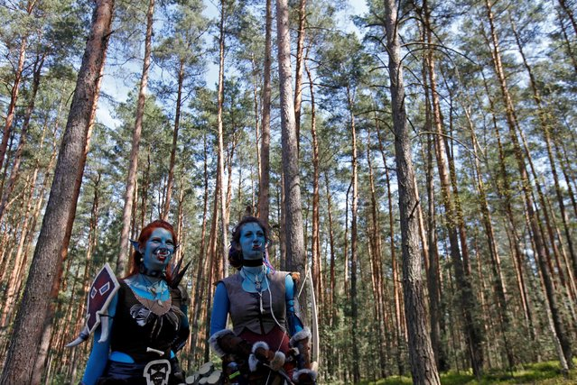 """Women dressed as characters from the computer game """"World of Warcraft"""" stand in a forest near the village of Sosnova, Czech Republic, April 30, 2016. (Photo by David W. Cerny/Reuters)"""