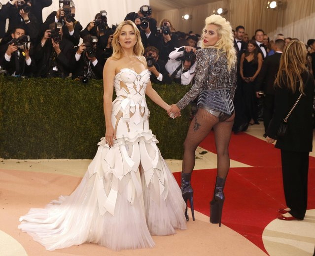 """Singer Lady Gaga (R) and actress Kate Hudson arrive at the Metropolitan Museum of Art Costume Institute Gala (Met Gala) to celebrate the opening of """"Manus x Machina: Fashion in an Age of Technology"""" in the Manhattan borough of New York, May 2, 2016. (Photo by Lucas Jackson/Reuters)"""