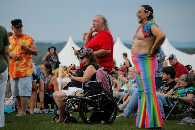 Guests attend the Arlo Guthrie concert at the Bethel Woods Center for the Arts, the original site of the Woodstock Festival, on the 50th anniversary in Bethel, New York, U.S. August 15, 2019. (Photo by Brendan McDermid/Reuters)
