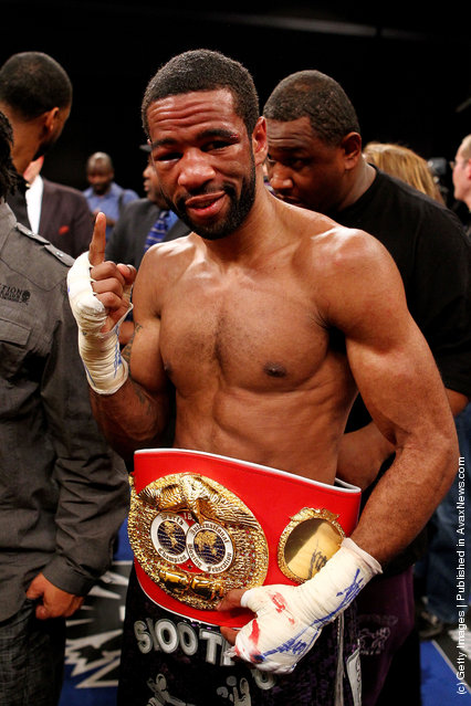 Lamont Peterson celebrates with the belt after defeating Amir Khan during the Capital Showdown: Khan v Peterson WBA/IBF World light-welterweight title bout at Washington Convention Center