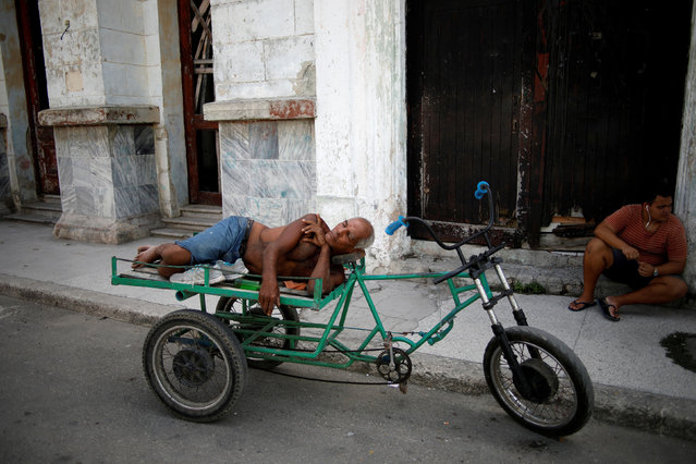 A man takes a nap on a tricycle in Havana, Cuba on September 7, 2019. (Photo by Fernando Medina/Reuters)