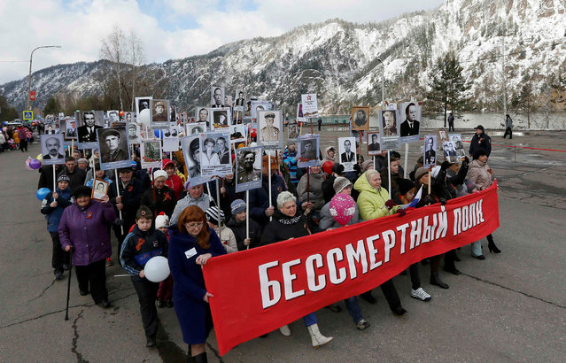People carry pictures of World War Two participants as they take part in the Immortal Regiment march during the Victory Day celebrations, marking the 71st anniversary of the victory over Nazi Germany in World War Two, in the town of Divnogorsk near Krasnoyarsk, Siberia, Russia, May 9, 2016. (Photo by Ilya Naymushin/Reuters)