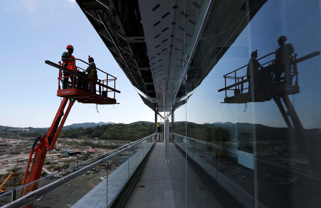 Employees work at new control tower of the Panama Canal expansion project on the Pacific side of the Panama Canal during an organized media tour by Italy's Salini Impregilo, one of the main sub contractors of the Panama Canal Expansion project, in Panama City May 11, 2016. (Photo by Carlos Jasso/Reuters)